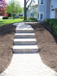Paverstone steps and sidewalk with landscaping
