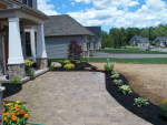 Custom patio and walls made of paverstone.