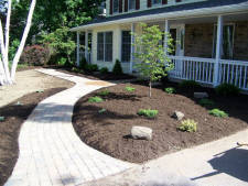 Paverstone sidewalk and mulched landscaping